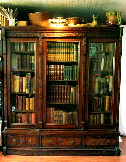 Photograph of Great Grandfather's bookcase and book collection.